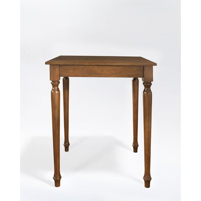 Crosley Turned Leg Pub Table in Classic Cherry