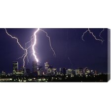'Lightning over a City' by Sakuno Stretched Canvas Art