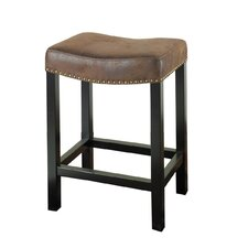 Tudor Wrangler Backless Barstool in Brown